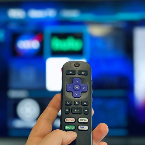 Hulu on Roku TV with a Roku remote and the dedicated Hulu button.