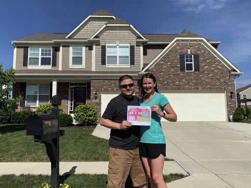 Mrs. Lemon and I standing in front of our home with our mortgage visualization fully colored in because we had just paid the mortgage off.